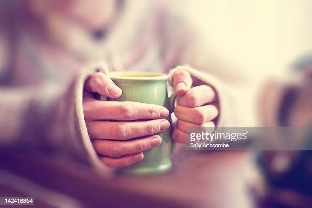 woman with mug of tea - mug stock pictures, royalty-free photos & images