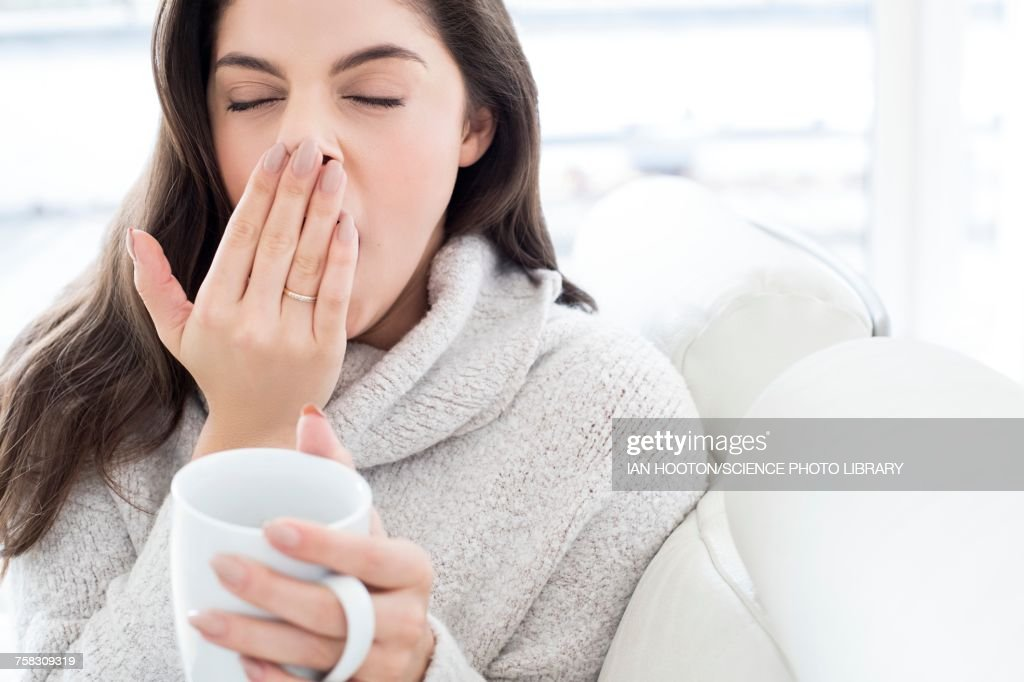 Woman with mug, yawning : Stock Photo