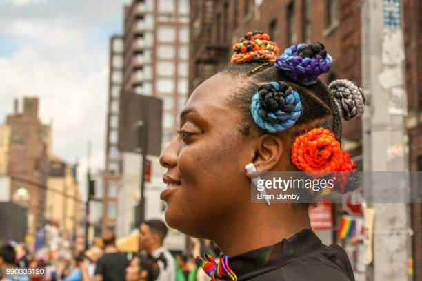 woman with multicolored hair at nyc gay pride parade - black transgender stock pictures, royalty-free photos & images
