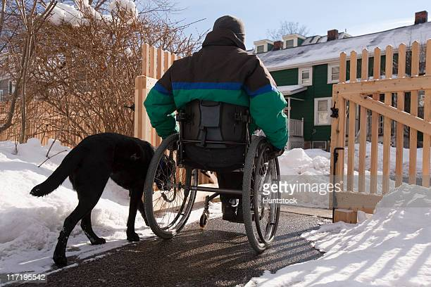 woman with multiple sclerosis leaving home with a service dog - multiple sclerosis stock photos and pictures