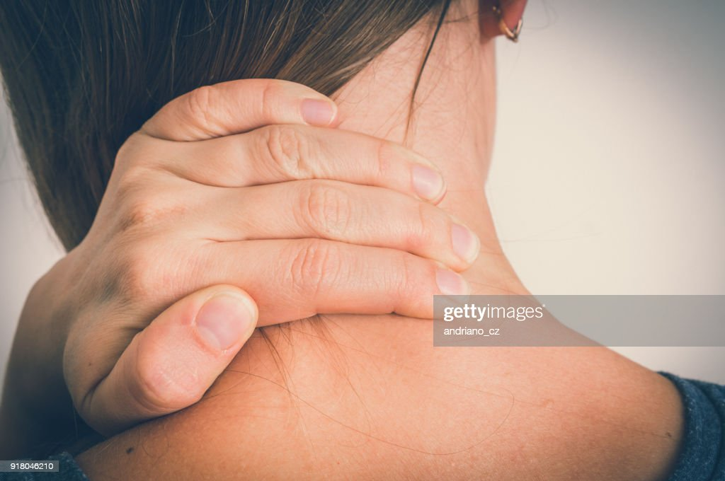 Woman with muscle injury having pain in her neck : Stock Photo
