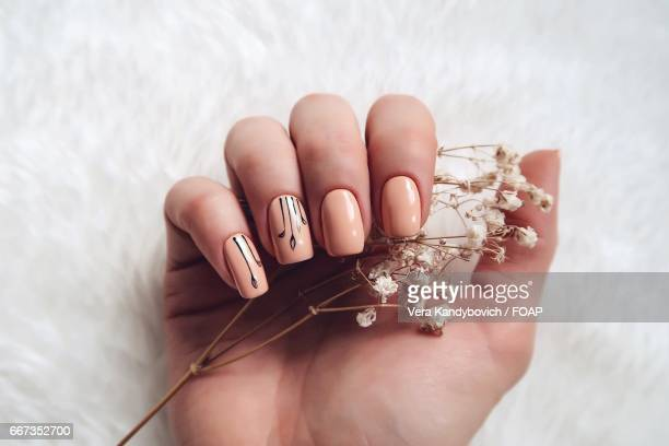 Woman with nail art holding flower