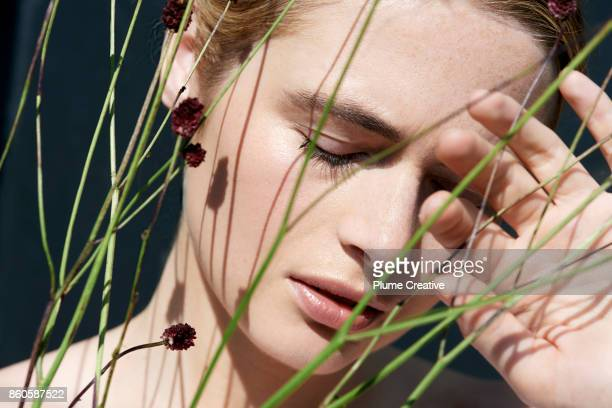 Woman with natural grasses