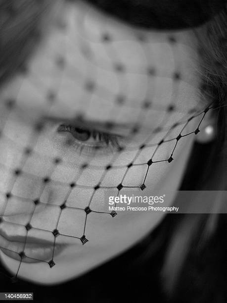 Woman with net on face