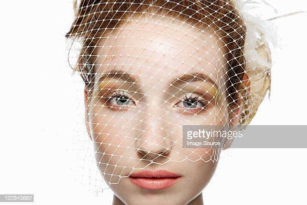 Woman with netting covering face