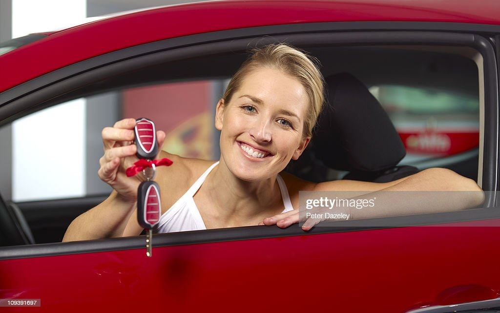 Woman with new car/present : Foto de stock