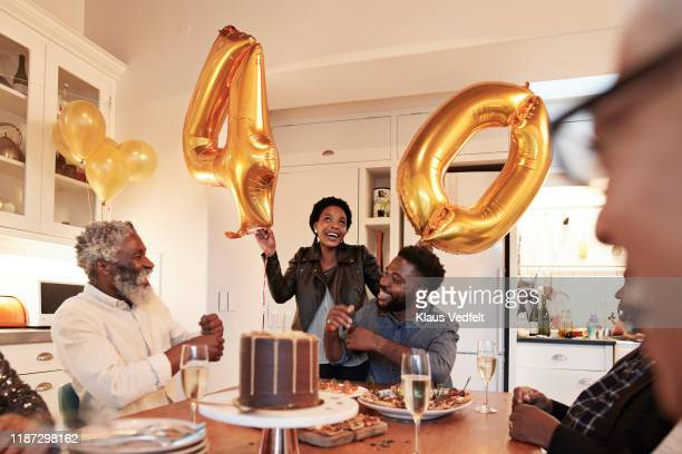 woman with number 40 balloons at birthday party - 数字の40 ストックフォトと画像