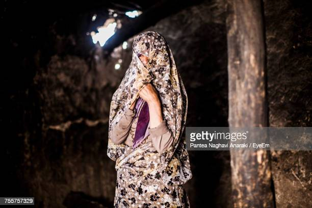 woman with obscure face wearing sari while standing at home - iran stock pictures, royalty-free photos & images