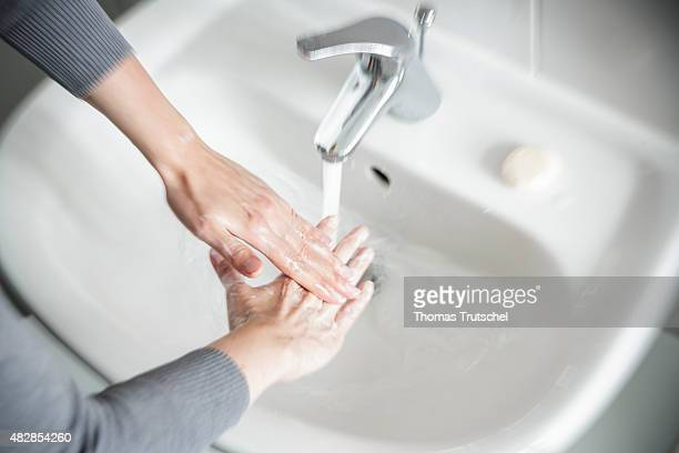 Woman with obsessive compulsie disorder is washing her hands