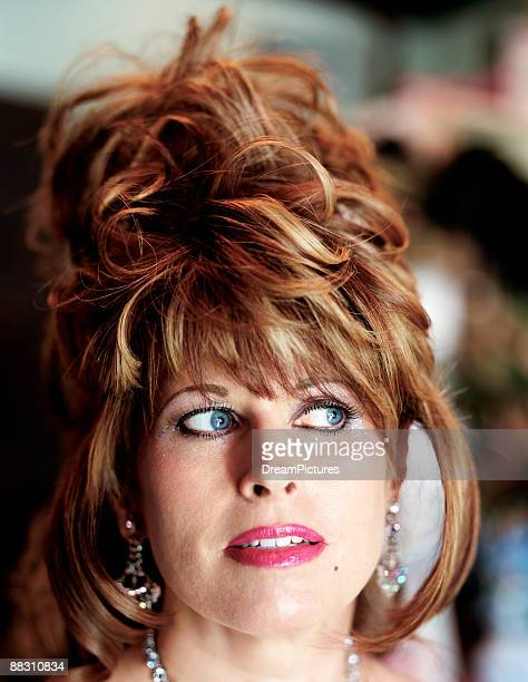 woman with odd hairstyle - big hair stock pictures, royalty-free photos & images