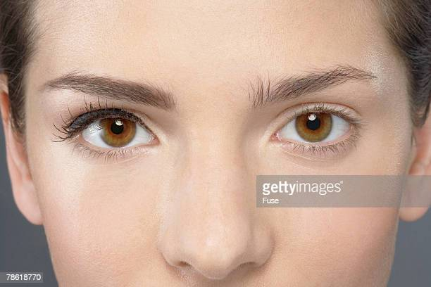 woman with one eye madeup - mismatch stock pictures, royalty-free photos & images