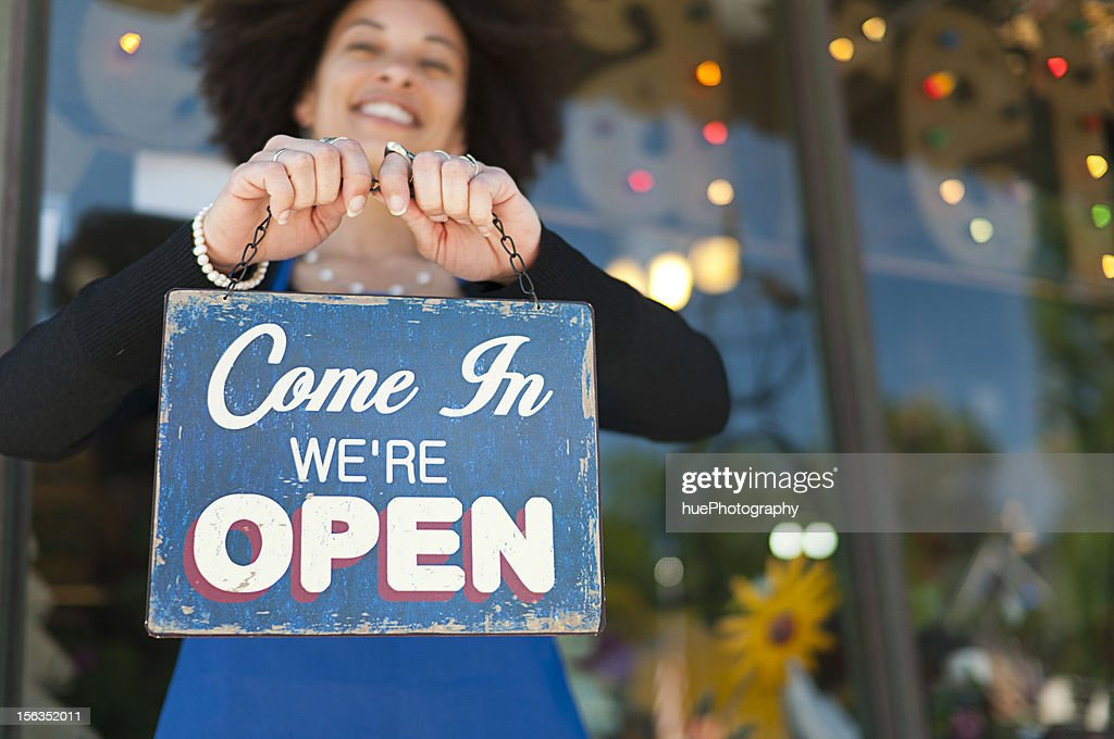 Woman with Open Sign : Stock Photo