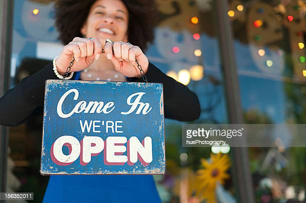 woman with open sign - business owner stock pictures, royalty-free photos & images
