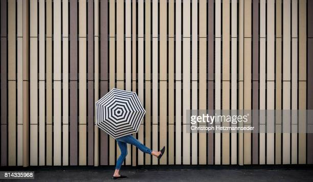 Woman with open umbrella
