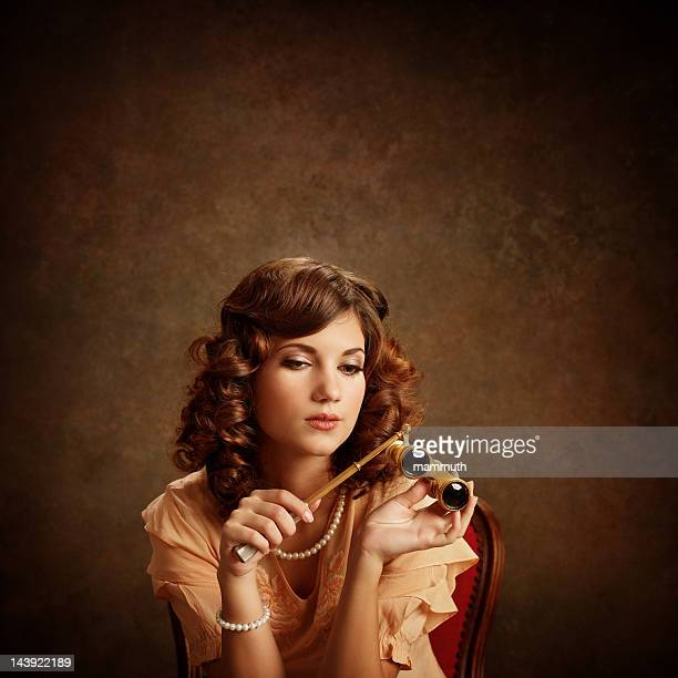 woman with opera glasses - victorian erotica stock photos and pictures
