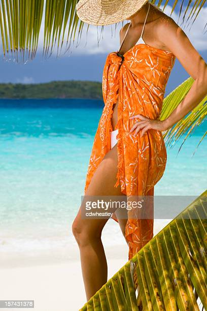 woman with orange sarong and hat
