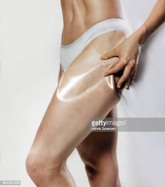 woman with pain in her buttock - mid section stock photos and pictures