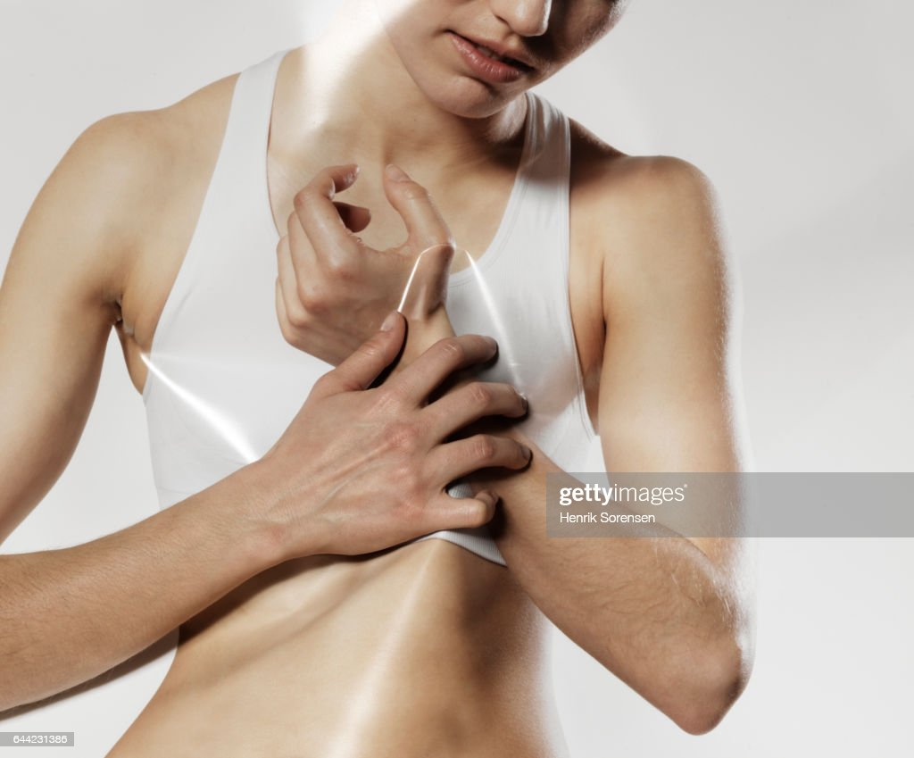 Woman with pain in her wrist : Stock Photo