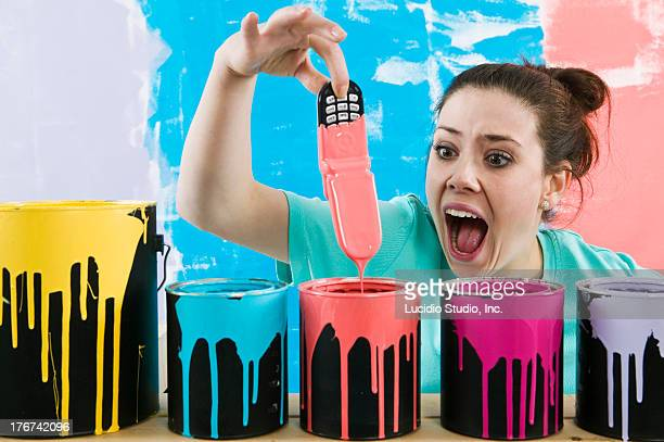 Woman with paint all over her cellphone