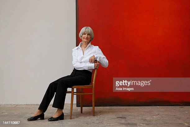 woman with painting - chair stock pictures, royalty-free photos & images