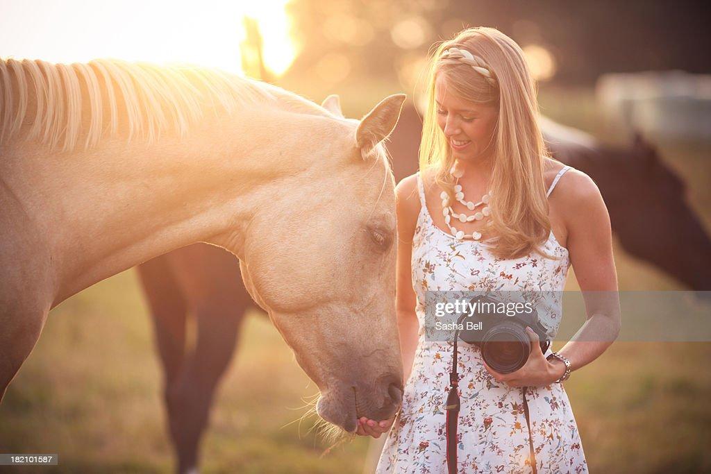 Woman with palomino horse : Stock Photo