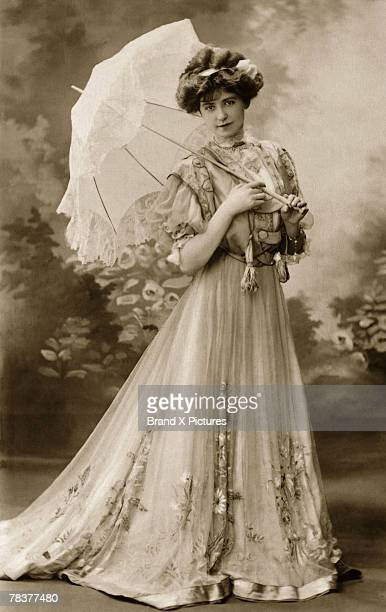 woman with parasol - 19th century style stock pictures, royalty-free photos & images