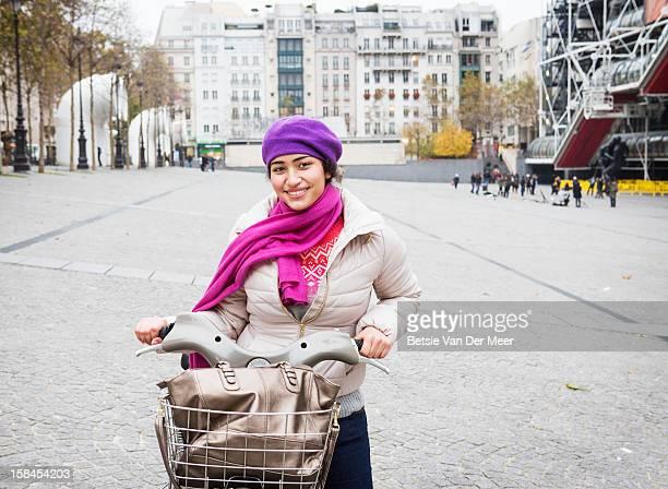 woman with parisian bike near centre pompidou. - centre pompidou stock pictures, royalty-free photos & images