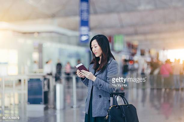 Woman with passport and boarding pass in airport