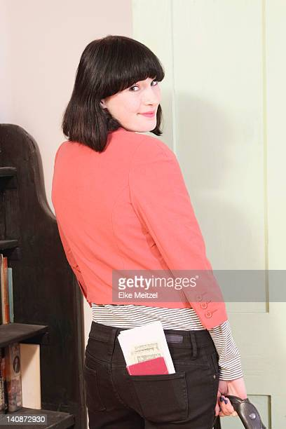 Woman with passport tucked in pocket