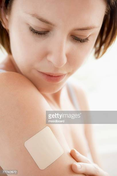 Woman with Patch on Arm