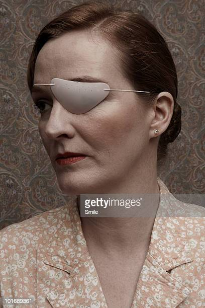 Woman with patch over her eye