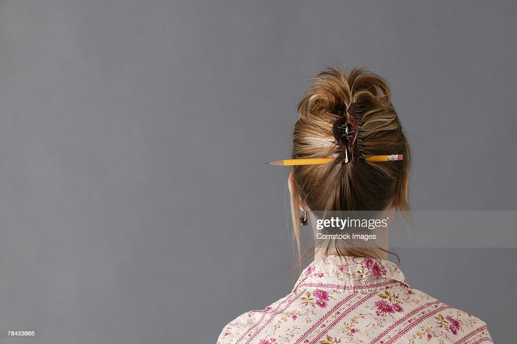 Woman with pencil in hair : Stockfoto