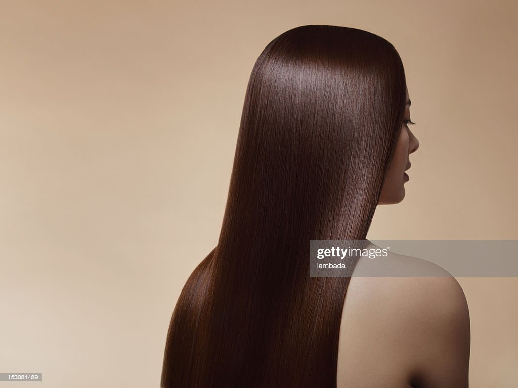 Woman with perfect straight hair : Stock Photo