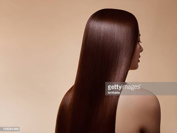woman with perfect straight hair - lang haar stockfoto's en -beelden