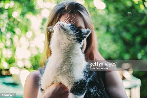 woman with pet cat - cat family stock pictures, royalty-free photos & images