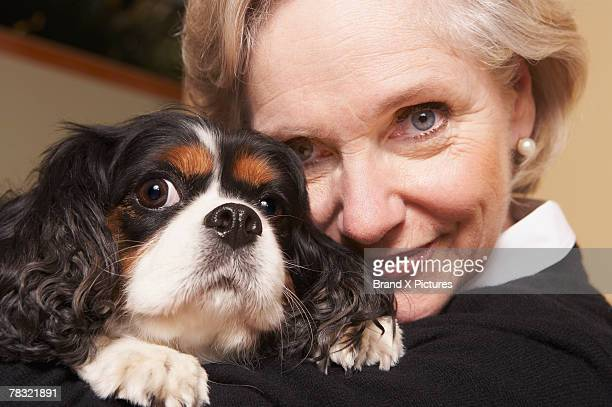 woman with pet dog - cavalier king charles spaniel stock pictures, royalty-free photos & images