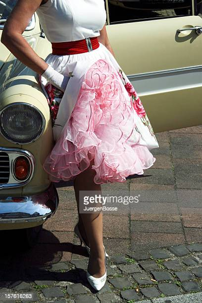 woman with petticoat leaning on car - women in slips stock photos and pictures