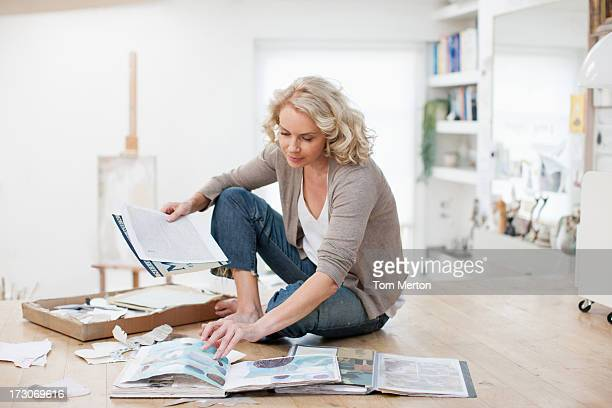 woman with photograph album and scrapbook - photo album stock photos and pictures