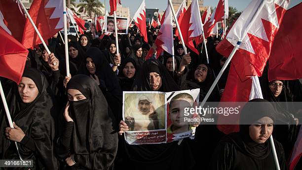 Woman with pictures of relatives who were killed by security forces. Bahrain remains deeply divided three years after the February 2011 uprising,...