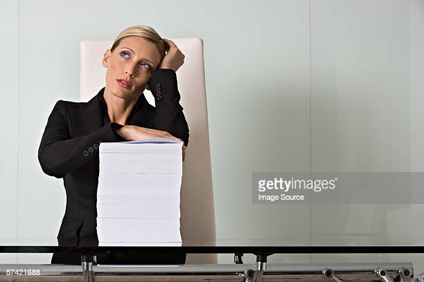 Woman with pile of paper