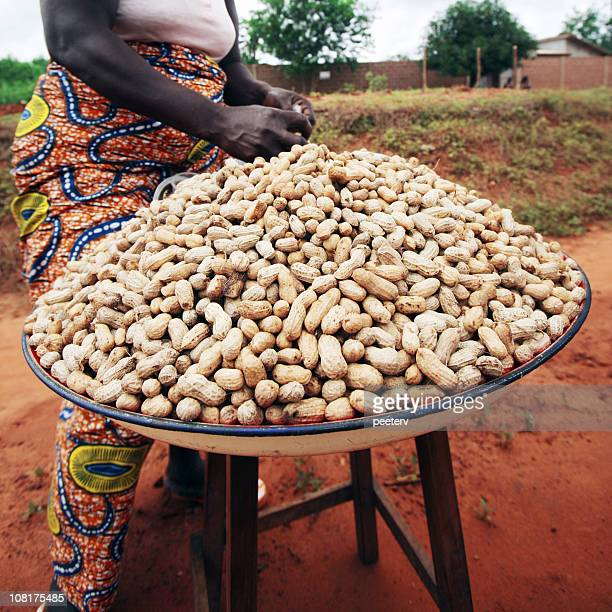 Woman with Pile of Peanuts