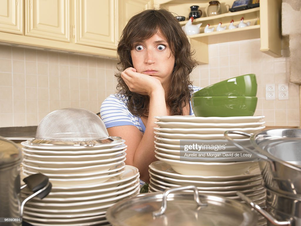 woman with piles of washing up : Stock Photo