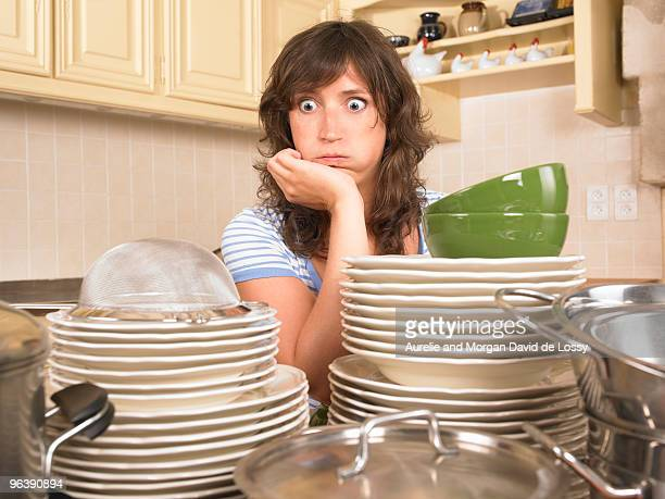 woman with piles of washing up