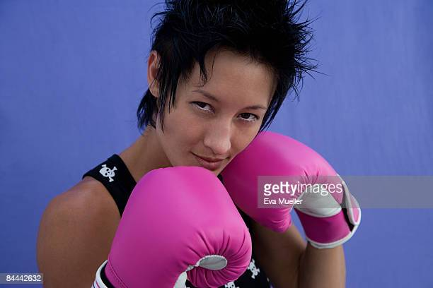 woman with pink boxing gloves  - women's boxing stock pictures, royalty-free photos & images