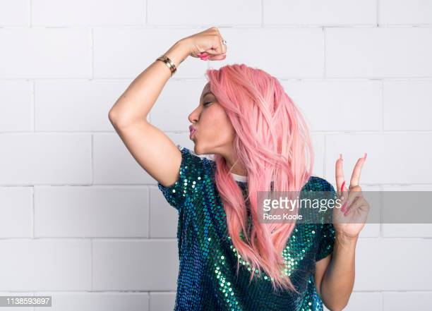 woman with pink hair - kraft stock-fotos und bilder