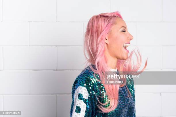 woman with pink hair - dyed hair stock pictures, royalty-free photos & images