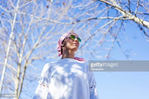 woman with pink headscarf, has cancer - women's issues stock pictures, royalty-free photos & images