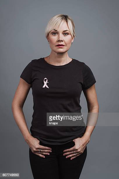Woman with pink ribbon breast cancer awareness symbol