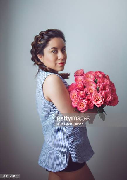 woman with pink roses - julia rose stock photos and pictures