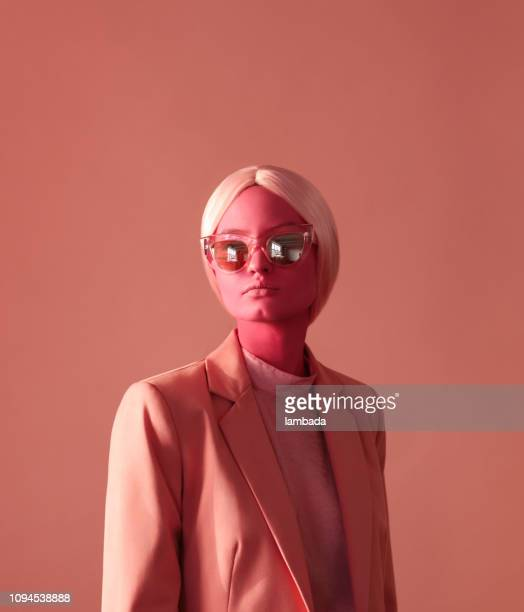 Woman with pink skin and pink eye glasses